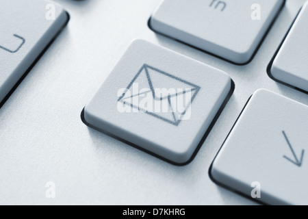 Internet email communication concept with a button on computer keyboard - Stock Photo