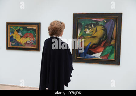 People look at the painting 'Tiger'(R) by Franz Marc in the new Lenbachhaus in Munich, Germany, 06 May 2013. The - Stock Photo