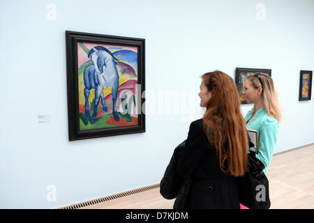 People look at the painting 'Blue Horse 1' by Franz Marc in the new Lenbachhaus in Munich, Germany, 06 May 2013. - Stock Photo