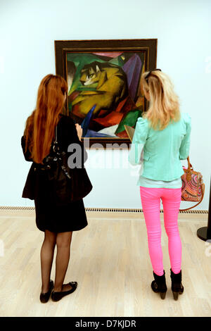 People look at the painting 'Tiger' by Franz Marc in the new Lenbachhaus in Munich, Germany, 06 May 2013. The Lenbachhaus - Stock Photo