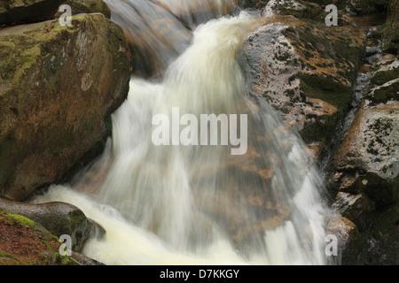Waterfall in mountain stream - Stock Photo