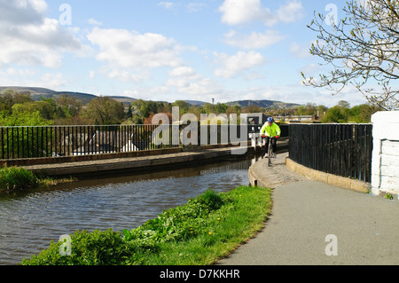 Cyclist crossing the Slateford Aqueduct on The Union Canal,Edinburgh. - Stock Photo