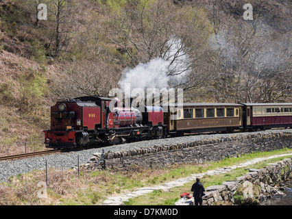 Welsh Highland Railway steam train with Pullman carriage travelling along Aberglaslyn Pass in Snowdonia. Beddgelert, North Wales, UK