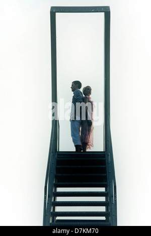 a couple on a diving platform - Stock Photo