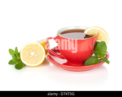 Red tea cup with lemon and mint. Isolated on white background - Stock Photo