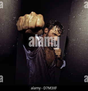 Fighting filthy guy with tough nature - Stock Photo