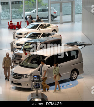 May 10, 2013, Yokohama, Japan - Visitors browse around at the spacious showroom of Nisan Motor Co.'s head office - Stock Photo
