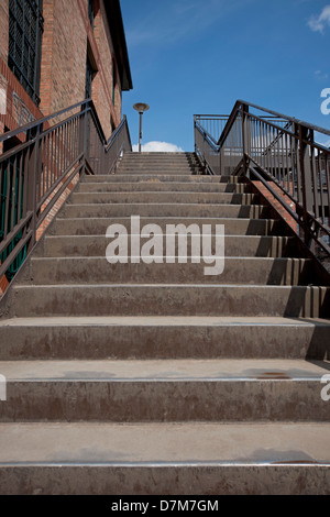 Looking up a flight of metal steps England UK United Kingdom GB Great Britain - Stock Photo