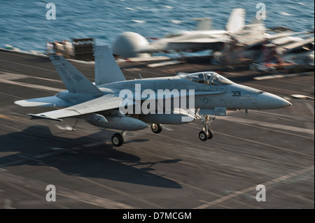 A US Navy F/A-18C Super Hornet lands on the flight deck of the aircraft carrier USS Nimitz May 8, 2013 underway - Stock Photo