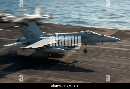 A US Navy F/A-18E Super Hornet lands on the flight deck of the aircraft carrier USS Nimitz May 8, 2013 underway - Stock Photo