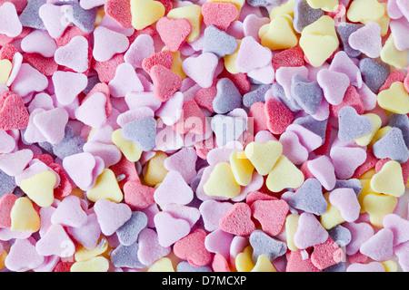 Heart-shaped sweets - Stock Photo