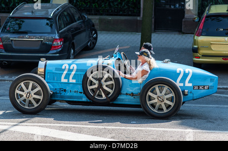 Couple driving a blue convertible Bugatti French vintage car Strasbourg Alsace France Europe - Stock Photo