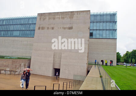 Two people leave the State Museum of Egyptian Art in Munich,Germany, 10 May 2013. The new opening of the museum - Stock Photo