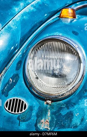 Headlight detail of rusty vintage Volkswagen Beetle - Stock Photo