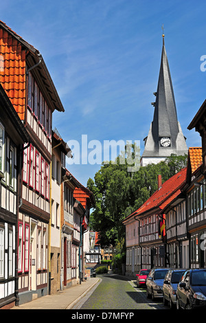 Half-timbered houses and St. Sixti-church in Northeim, Lower Saxony, Germany - Stock Photo