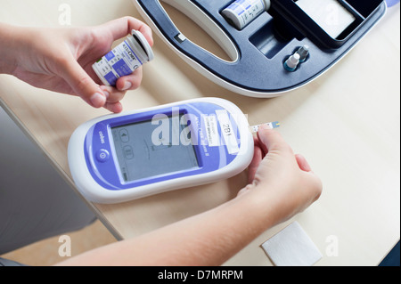 Blood glucose meter - Stock Photo