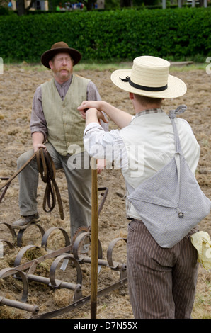 Michigan, Wyandotte. Greenfield Village,. Historical demonstration of farming early tobacco plantation, period costume. - Stock Photo
