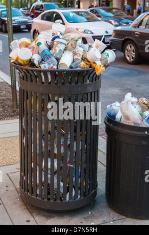 Overflowing rubbish bin - Stock Photo