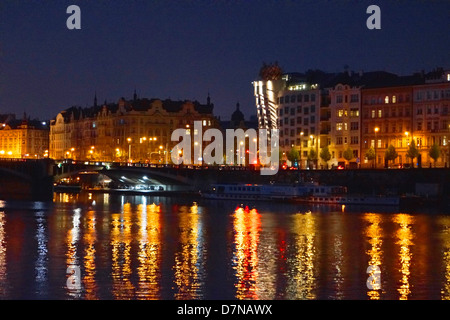 View from the River Vltava, Prague showing a night view of the, 'Dancing House' and other buildings on the river side. Stock Photo