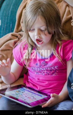 Young girl using ipad - Stock Photo