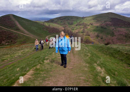 a woman and a group of people walking in the malvern hills, worcestershire, - Stock Photo