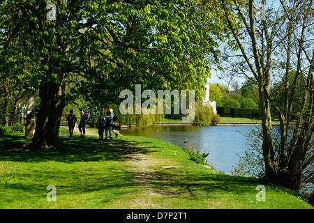 Walkers on the Thames Path at Medmenham Abbey, Medmenham - Stock Photo