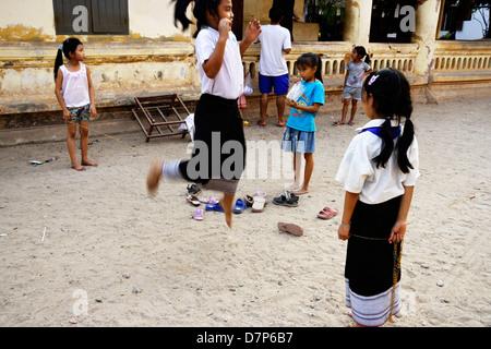 Laotian girls playing in school playground . Vientiane , Laos - Stock Photo