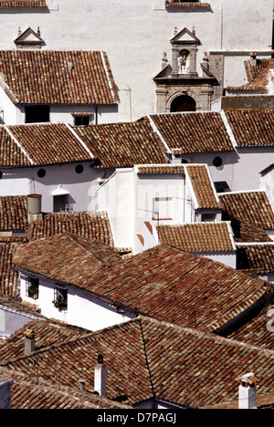 Typical whitewashed village with barrel roof tiles in the Pueblos Blancos region Arcos de la frontera in Andalusia - Stock Photo