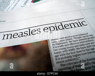 An article about the measles epidemic in Britain in the Guardian newspaper UK Spring 2013 - Stock Photo