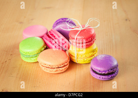 traditional french colorful macarons on wooden table - Stock Photo