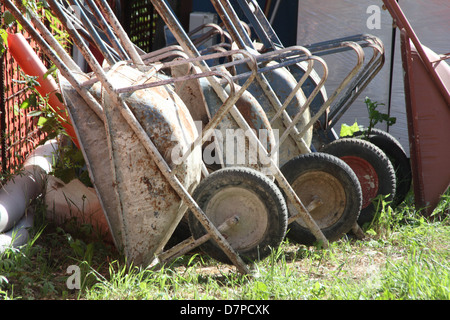 lots of wheelbarrows on building site - Stock Photo
