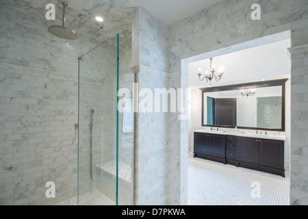 Large modern Italian bathroom with walk in shower. - Stock Photo