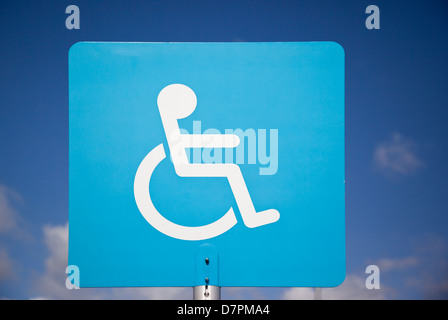 Close up of a blue disabled parking sign at a Sainsburys store in Wiltshire - Stock Photo