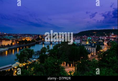 Skyline view over the Vltava river and bridges in Prague at sunset, Czech Republic - Stock Photo
