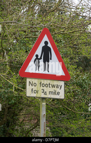 """A british traffic sign warning that the road has """"No footway """", is a modern graphic design classic by Jock Kinneir - Stock Photo"""