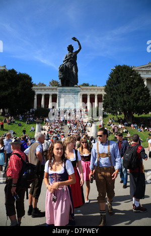 Oktoberfest, tourist in front of BAVARIA monument, Theresienwiese,  Munich, Bavaria, Germany - Stock Photo