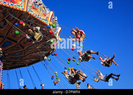 Oktoberfest, Theresienwiese, traditionelles Kettenkarrussel, Chairoplane, Carousel, Munich, Bavaria, Germany - Stock Photo