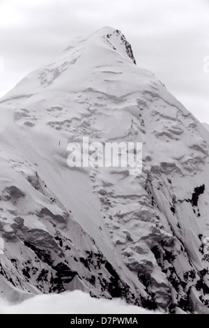 Black and white view of Mt. McKinley (Denali Mountain), highest point N America 20,320' peaking above clouds, Denali - Stock Photo