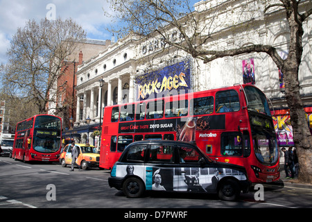 Exterior of the Carrick Theatre showing London buses, West End, London, England, United Kingdom - Stock Photo
