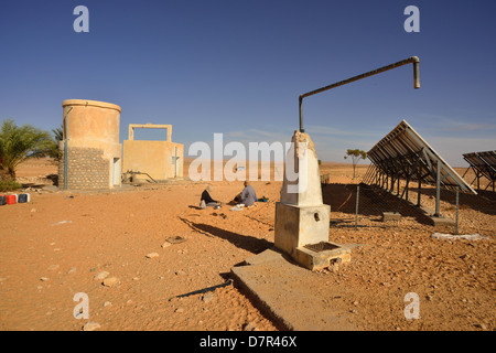 Solar Panels generating Electricity for a water pumpstation in the desert near Douz, South of Tunisia. - Stock Photo