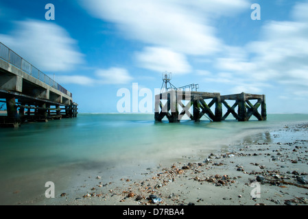 Eastney Pier and remains of World War Two concrete piers. Long Exposure - Stock Photo