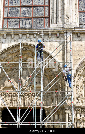 CHARTRES - MAY 19: Workers restore exterior of the medieval Cathedral on May 19, 2010 in Chartres, France. - Stock Photo