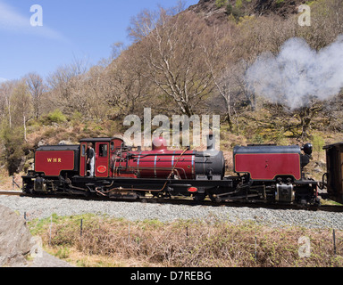Welsh Highland Railway vintage steam train travelling along Aberglaslyn Pass in Snowdonia. Beddgelert, Gwynedd, North Wales, UK