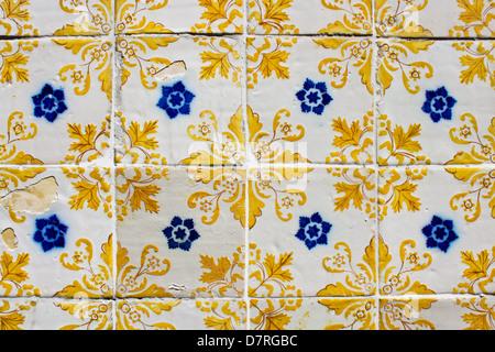 Traditional portuguese azulejos on a wall in Porto - Stock Photo