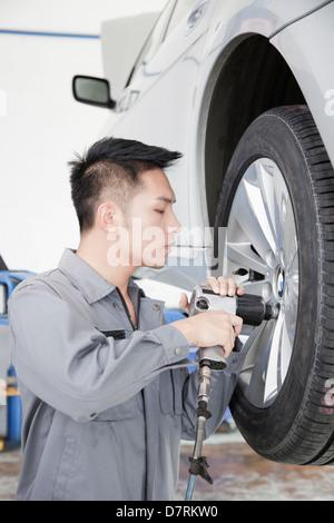 Mechanic Using Power Tool - Stock Photo