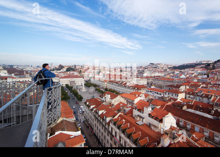 Lisbon, Portugal. Tourist at the top of the Santa Justa Lift looking at the view of the Rossio square or Praça de - Stock Photo
