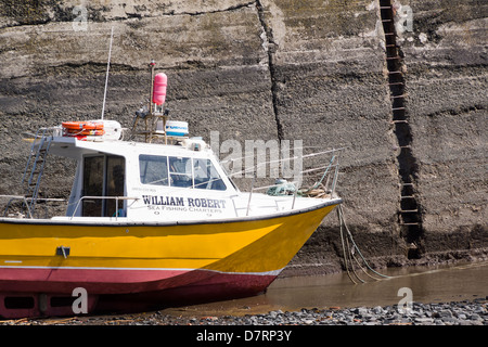 A small fishing boat at Craster harbour in Northumberland. - Stock Photo