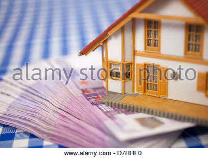 Close-up of a model home on euros - Stock Photo