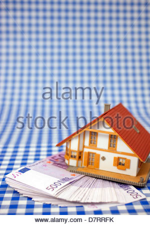 Close-up of a model home on 500 euro notes - Stock Photo