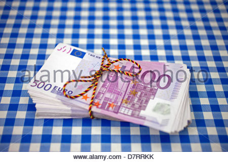 Close-up of a bundle of 500 euro notes tied with a thread - Stock Photo